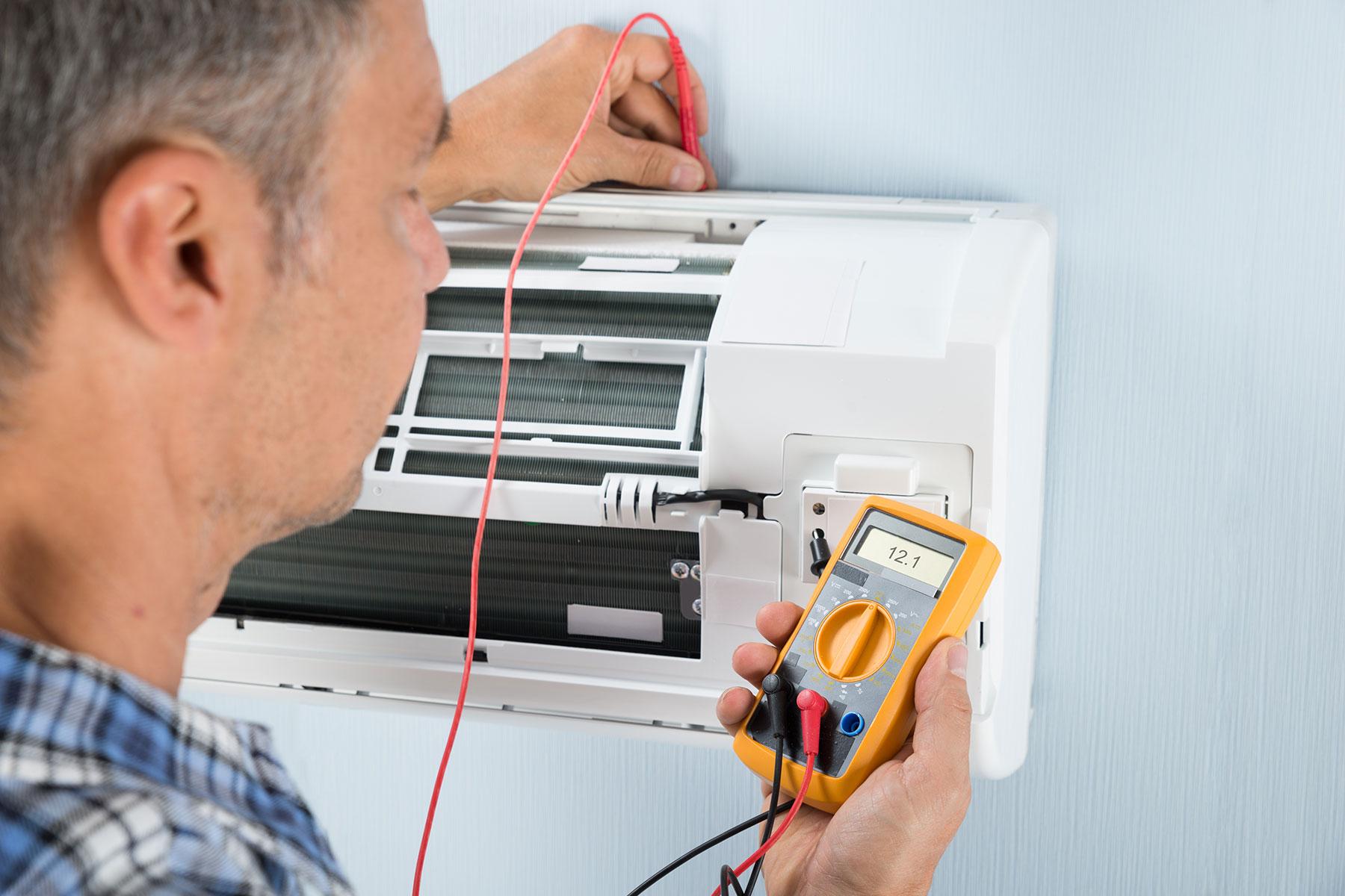 man-checking-air-conditioning-unit-fresno-ca